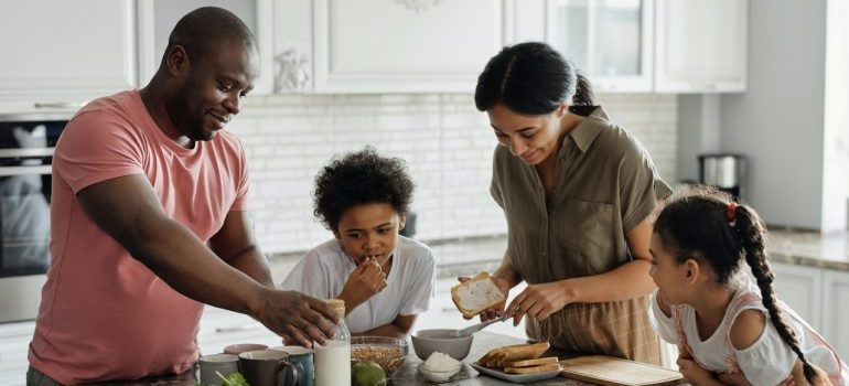 A family having breakfast in the kitchen constructed by kitchen remodeling contractor Los Angeles