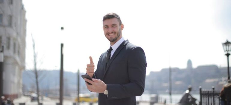 A businessman holding a thumb up.
