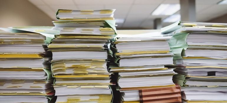 Several piles of documents.