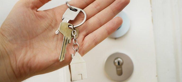 keys in hand in front of doors