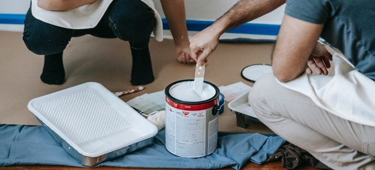two people using painting supplies