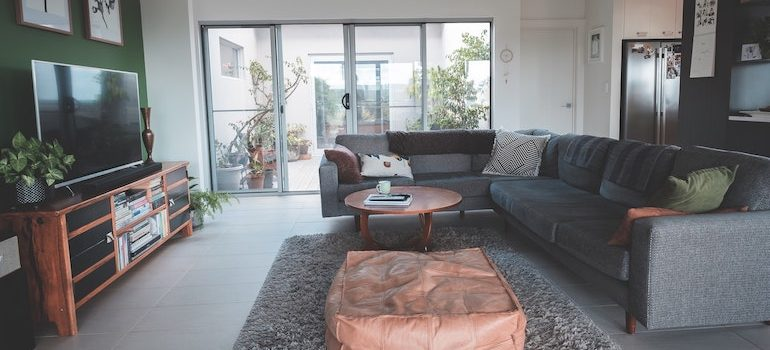 a living room with a sofa and a big window