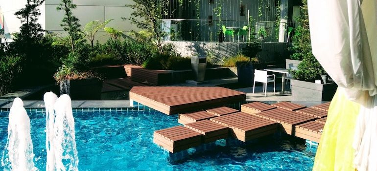 a swimming pool with wood parts