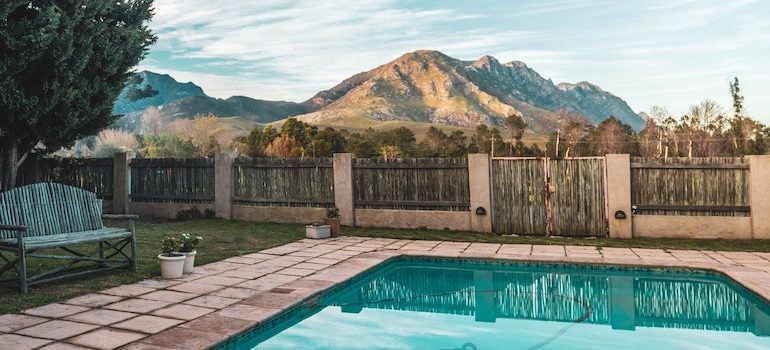 a swimming pool and a mountain in background